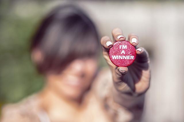 """Photographie d'un jeton où est inscrit """"je suis un gagnant !"""""""